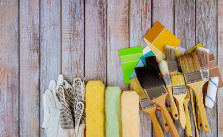Photo for Paint decorator work with house project various brushes color choice palette painting roller - Royalty Free Image