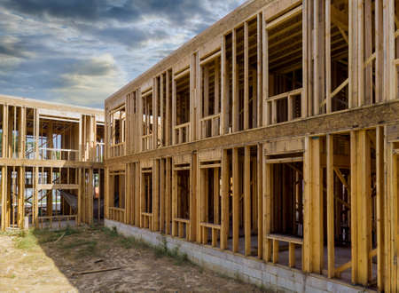 Photo for Building of New Home Construction exterior wood frame and beam construction against a blue sky - Royalty Free Image
