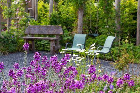 Photo pour Naturral Garden design with wooden bech and chairs. - image libre de droit