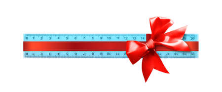 Photo pour Science and education - Plastic blue school ruler gift tied red bow isolated on a white background. - image libre de droit