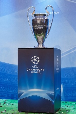 UEFA Champions League trophy on a blue background