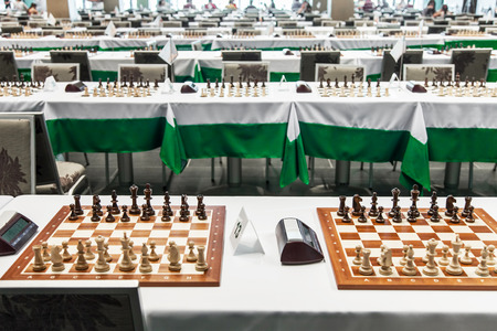 Chess board with figures before starting chess tournament