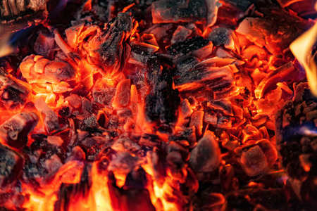 Photo for Glowing embers in hot red color, abstract background. The hot embers of burning wood log fire. Firewood burning on grill. Texture fire bonfire embers. - Royalty Free Image