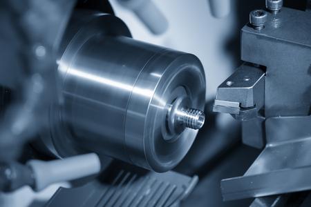 Foto für The CNC lathe  cutting the thread at the metal parts. The hi-technology automotive parts manufacturing process by turning machine. - Lizenzfreies Bild