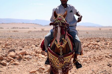 Moroccan riders on the road to marrakech close to the city of Tata in Morocco