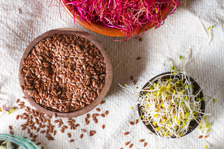 Colourful and healthy crunchy mixed seeds and various sprouts. Linseed, alfalfa, red beet sprouts.