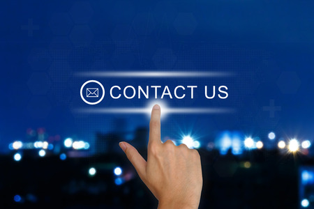 hand clicking contact us button on a touch screen interface
