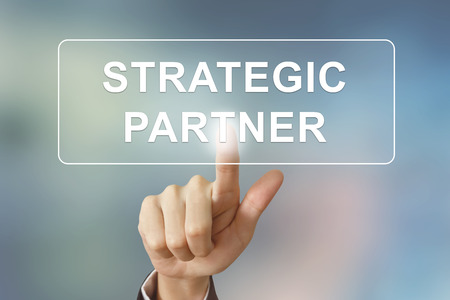 Photo pour business hand pushing strategic partner button on blurred background - image libre de droit