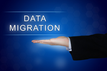 data migration button with business hand on blue background