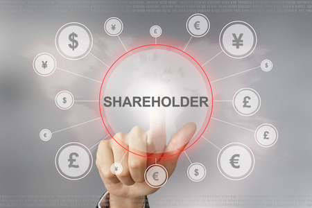 hand pushing shareholder button with global networking concept