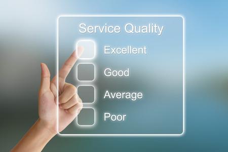 Photo pour hand clicking service quality on virtual screen interface - image libre de droit