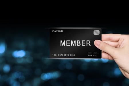 Photo pour hand picking member platinum card on blur background - image libre de droit
