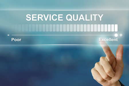 Photo pour business hand pushing excellent service quality on virtual screen interface - image libre de droit