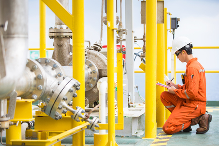 Foto de Mechanical engineer inspector inspection crude oil pump centrifugal type at offshore oil and gas central processing platform, maintenance and service for specialist job. - Imagen libre de derechos