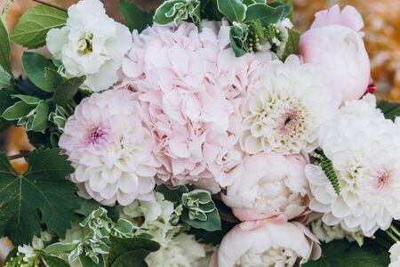 Photo for Wedding asymmetric bouquet of eustoma, peonies, dahlias, hydrangeas. - Royalty Free Image