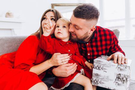 Photo pour Happy family in red dress. Happy childhood. - image libre de droit