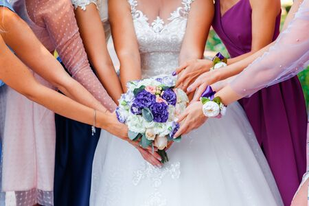 Photo for Wedding bouquet in the hands of the bride. Many hands of girl. - Royalty Free Image