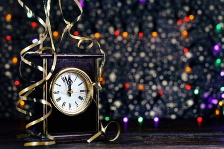 Happy New Year. Old clock on abstract background