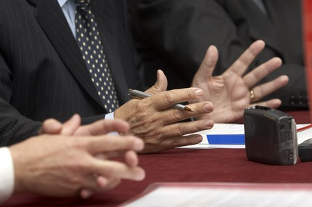 close up of conference meeting speacher gestures