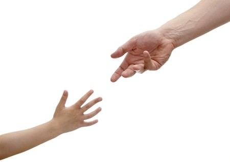 close up of child and adult reaching out hands, on white background