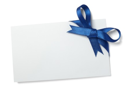 close up of  card note with blue ribbon