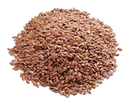 close up of flax seeds on white background