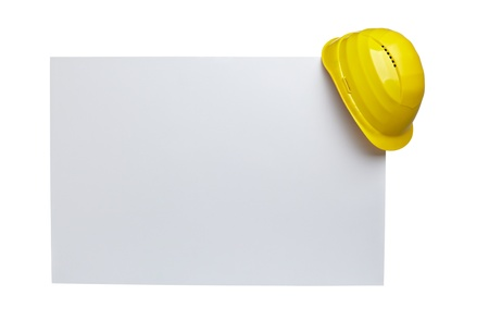 Photo for close up of  a yellow construction helmet on white blank note white background with clipping path - Royalty Free Image