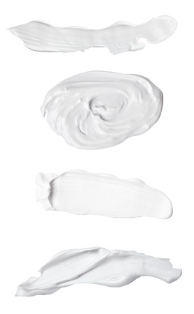 collection of various beauty cream strokes on white background. each one is shot separately