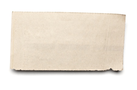 close up of  a white ripped piece of news paper on on white background