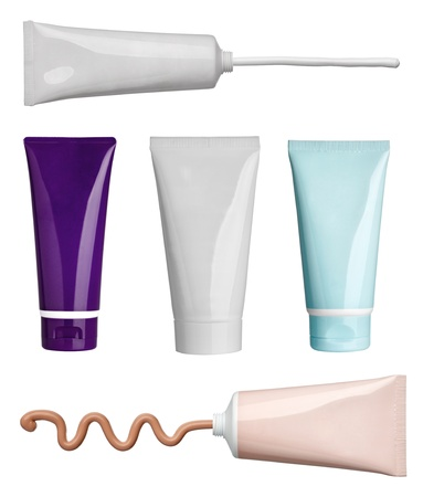 collection of various beauty cream and powder strokes and tubes on white background. each one is shot separately
