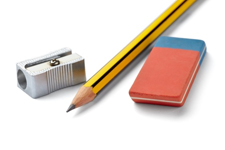 close up of  pencil, eraser and sharpener on white background