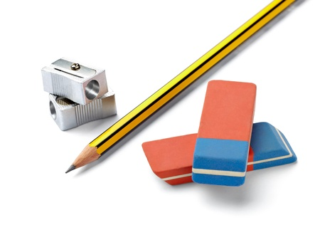 close up of  pencil, eraser and sharpener on white background with clipping path