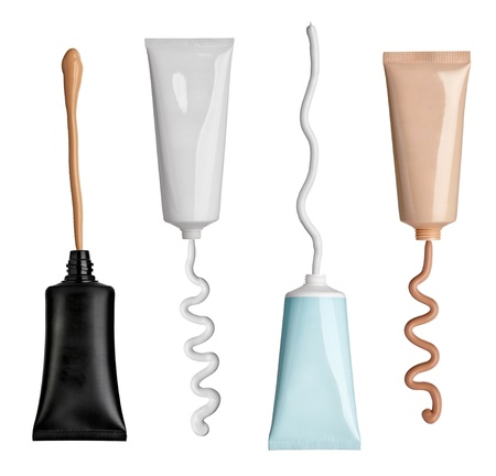 collection of various beauty cream and powder strokes and tubes on white background.
