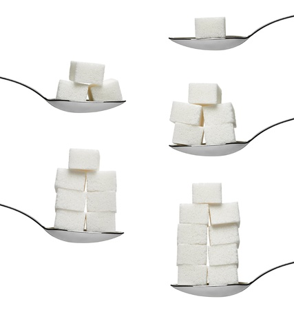 sugar cubes in aspoon