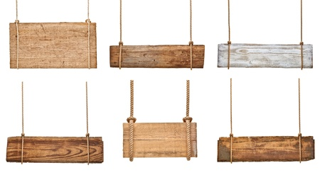 collection of various empty wooden signs hanging on a rope on white background