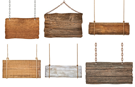 collection of various empty wooden signs hanging on a rope and chain on white background  each one is shot separately