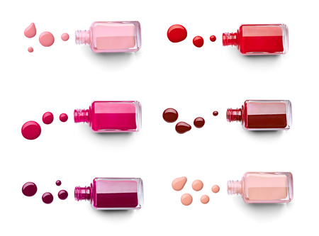 collection of various nail polish bottle and drop on white background. each one is shor separately
