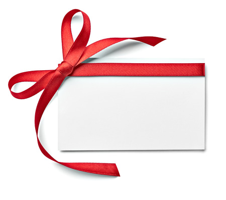 Photo for close up of a note card with ribbon bow on white background - Royalty Free Image