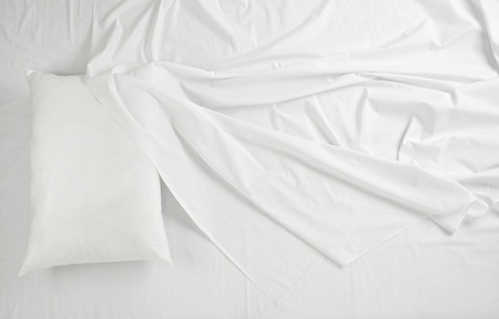 Foto de close up of bedding sheets and pillow - Imagen libre de derechos