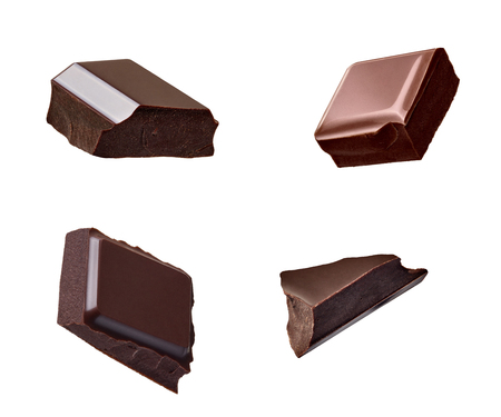 Photo pour close up of chocolate pieces falling on white background - image libre de droit