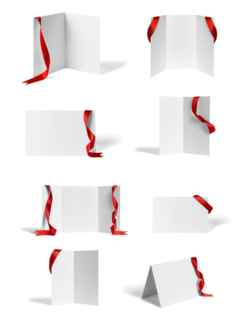 Photo pour collection of various  blank folded leaflet or a desktop calendar with ribbon on white background. each on is shot separately - image libre de droit