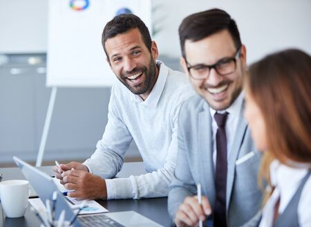 Photo for A portrait of a young smiling businessman  a meeting and presentation in the office. Business concept - Royalty Free Image