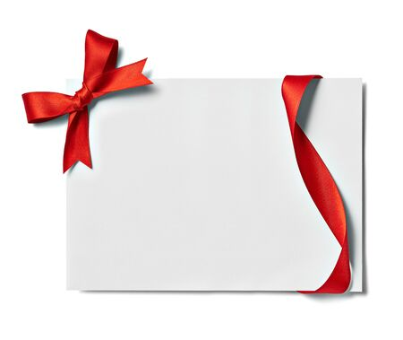 Photo for close up of a note card with red ribbon bow on white background - Royalty Free Image