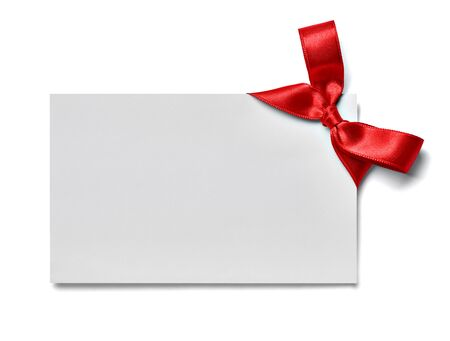 Photo for close up of a greeting card note with red ribbon on white background - Royalty Free Image