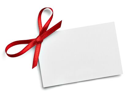 Photo pour close up of a note card with red ribbon bow on white background - image libre de droit