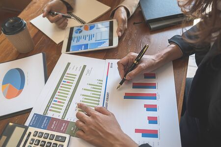 Photo pour Business team brainstorming and discussing with financial data and report graph. Teamwork meeting working concept. - image libre de droit
