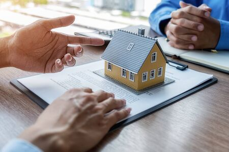 Photo pour House model with agent and customer discussing for contract to buy, get insurance or loan real estate or property. - image libre de droit