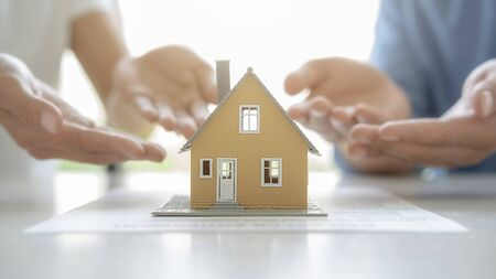 Photo pour House model with agent asking costumer for contract to buy, get insurance or loan real estate or property. - image libre de droit