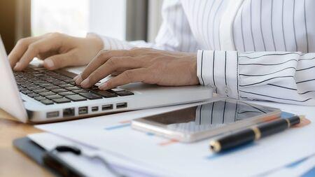 Foto de Business women using laptop to checking the company performance chart. Business concept. - Imagen libre de derechos