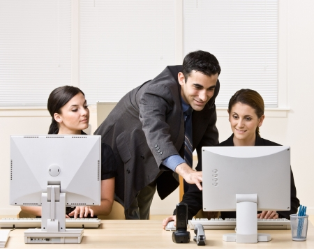 Businessman helping co-worker with work